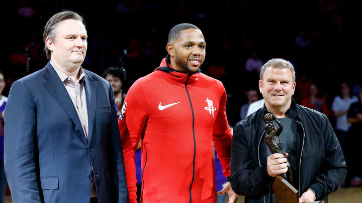 HOUSTON, TX – OCTOBER 23: Eric Gordon #10 of the Houston Rockets receives from Tillman Fertita, right, and Darryl Money the 2017 NBA Sixth Man of the Year Award at Toyota Center on October 23, 2017 in Houston, Texas. NOTE TO USER: User expressly acknowledges and agrees that, by downloading and or using this photograph, User is consenting to the terms and conditions of the Getty Images License Agreement. (Photo by Bob Levey/Getty Images)