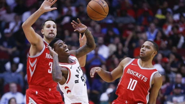 HOUSTON, TX - NOVEMBER 14: Delon Wright #55 of the Toronto Raptors is fouled by Eric Gordon #10 of the Houston Rockets as h reaches for the ball as Ryan Anderson #33 looks on at Toyota Center on November 14, 2017 in Houston, Texas. NOTE TO USER: User expressly acknowledges and agrees that, by downloading and or using this photograph, User is consenting to the terms and conditions of the Getty Images License Agreement. (Photo by Bob Levey/Getty Images)