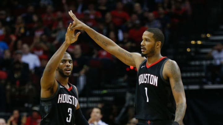 Chris Paul, Trevor Ariza of the Houston Rockets (Photo by Bob Levey/Getty Images)