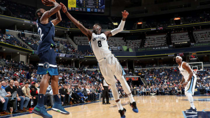 MEMPHIS, TN - DECEMBER 4: Andrew Wiggins #22 of the Minnesota Timbewolves shoots the ball as James Ennis III #8 of the Memphis Grizzlies attempts to block during the game between the two teams on December 4, 2017 at FedEx Forum in Memphis, Tennessee. NOTE TO USER: User expressly acknowledges and agrees that, by downloading and/or using this photograph, user is consenting to the terms and conditions of the Getty Images License Agreement. Mandatory Copyright Notice: Copyright 2017 NBAE (Photo by Joe Murphy/NBAE via Getty Images)