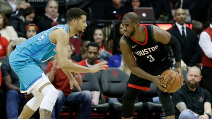 HOUSTON, TX - DECEMBER 13: Chris Paul #3 of the Houston Rockets looks to drive on Michael Carter-Williams #10 of the Charlotte Hornets in the fourth qaurter at Toyota Center on December 13, 2017 in Houston, Texas. NOTE TO USER: User expressly acknowledges and agrees that, by downloading and or using this photograph, User is consenting to the terms and conditions of the Getty Images License Agreement. (Photo by Bob Levey/Getty Images)