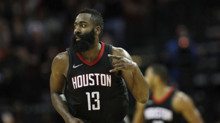 HOUSTON, TX - DECEMBER 22: James Harden #13 of the Houston Rockets reacts after a three point shot in the second half against the LA Clippers at Toyota Center on December 22, 2017 in Houston, Texas. NOTE TO USER: User expressly acknowledges and agrees that, by downloading and or using this Photograph, user is consenting to the terms and conditions of the Getty Images License Agreement. (Photo by Tim Warner/Getty Images)