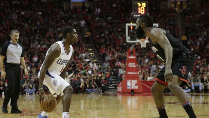 HOUSTON, TX - DECEMBER 22: Jawun Evans #1 of the LA Clippers controls the ball defended by James Harden #13 of the Houston Rockets in the second half at Toyota Center on December 22, 2017 in Houston, Texas. NOTE TO USER: User expressly acknowledges and agrees that, by downloading and or using this Photograph, user is consenting to the terms and conditions of the Getty Images License Agreement. (Photo by Tim Warner/Getty Images)