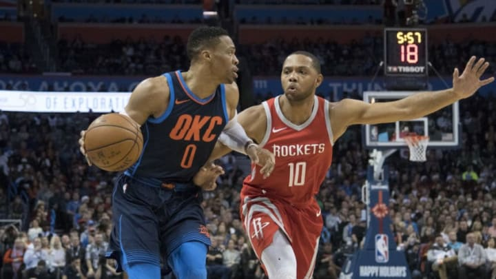 Russell Westbrook #0 of the Oklahoma City Thunder works his way around Eric Gordon #10 of the Houston Rockets (Photo by J Pat Carter/Getty Images)