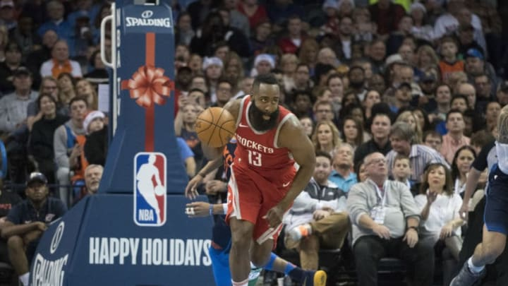 OKLAHOMA CITY, OK - DECEMBER 25: James Harden #13 of the Houston Rockets steals the ball away Andre Roberson #21 of the Oklahoma City Thunder during the second half of a NBA game at the Chesapeake Energy Arena on December 25, 2017 in Oklahoma City, Oklahoma. The Thunder defeated the Rockets 112-107. NOTE TO USER: User expressly acknowledges and agrees that, by downloading and or using this photograph, User is consenting to the terms and conditions of the Getty Images License Agreement. (Photo by J Pat Carter/Getty Images)