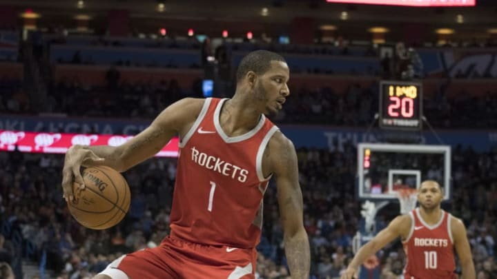 OKLAHOMA CITY, OK - DECEMBER 25: Trevor Ariza #1 of the Houston Rockets brings the ball down court against the Oklahoma City Thunder during the second half of a NBA game at the Chesapeake Energy Arena on December 25, 2017 in Oklahoma City, Oklahoma. The Thunder defeated the Rockets 112-107. NOTE TO USER: User expressly acknowledges and agrees that, by downloading and or using this photograph, User is consenting to the terms and conditions of the Getty Images License Agreement. (Photo by J Pat Carter/Getty Images)