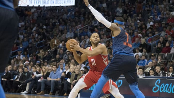 OKLAHOMA CITY, OK - DECEMBER 25: Carmelo Anthony #7 of the Oklahoma City Thunder blocks Eric Gordon #10 of the Houston Rockets during the second half of a NBA game at the Chesapeake Energy Arena on December 25, 2017 in Oklahoma City, Oklahoma. The Thunder defeated the Rockets 112-107. NOTE TO USER: User expressly acknowledges and agrees that, by downloading and or using this photograph, User is consenting to the terms and conditions of the Getty Images License Agreement. (Photo by J Pat Carter/Getty Images)