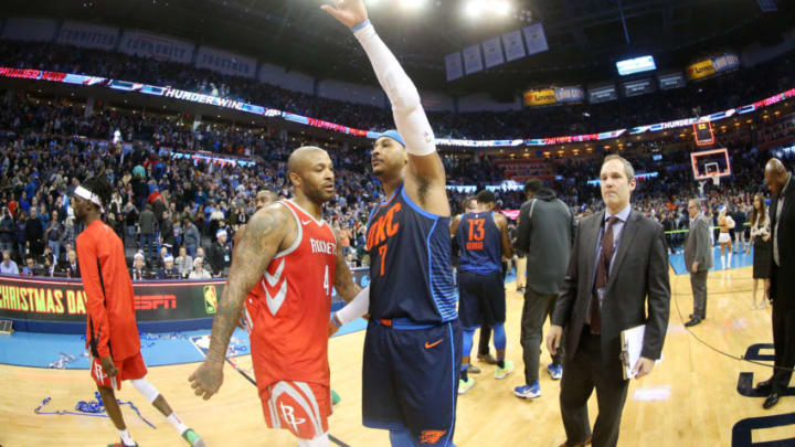 OKLAHOMA CITY, OK- DECEMBER 25: PJ Tucker #4 of the Houston Rockets and Carmelo Anthony #7 of the Oklahoma City Thunder exchange a hug after the game between the two teams on December 25, 2017 at Chesapeake Energy Arena in Oklahoma City, Oklahoma. NOTE TO USER: User expressly acknowledges and agrees that, by downloading and or using this photograph, User is consenting to the terms and conditions of the Getty Images License Agreement. Mandatory Copyright Notice: Copyright 2017 NBAE (Photo by Layne Murdoch Sr./NBAE via Getty Images)