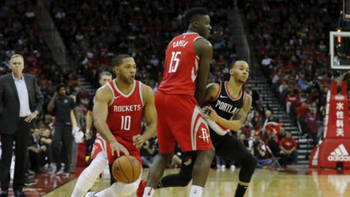 HOUSTON, TX – JANUARY 10: Eric Gordon #10 of the Houston Rockets dribbles around Clint Capela #15 defended by Shabazz Napier #6 of the Portland Trail Blazers in the second half at Toyota Center on January 10, 2018 in Houston, Texas. NOTE TO USER: User expressly acknowledges and agrees that, by downloading and or using this Photograph, user is consenting to the terms and conditions of the Getty Images License Agreement. (Photo by Tim Warner/Getty Images)