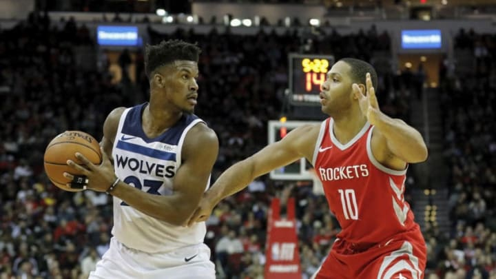 Jimmy Butler #23 of the Minnesota Timberwolves controls the ball defended by Eric Gordon #10 of the Houston Rockets (Photo by Tim Warner/Getty Images)