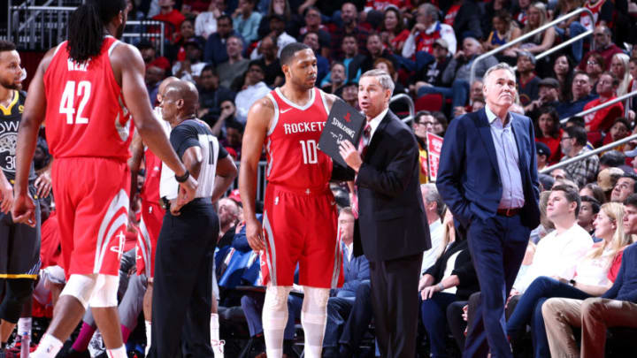 HOUSTON, TX - JANUARY 20: Assistant Coach Jeff Bzdelik of the Houston Rockets speaks with Eric Gordon #10 and Nene Hilario #42 of the Houston Rockets during the game against the Golden State Warriors on January 20, 2018 at the Toyota Center in Houston, Texas. NOTE TO USER: User expressly acknowledges and agrees that, by downloading and or using this photograph, User is consenting to the terms and conditions of the Getty Images License Agreement. Mandatory Copyright Notice: Copyright 2018 NBAE (Photo by Nathaniel Butler/NBAE via Getty Images)