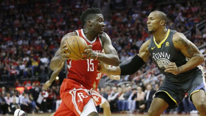 HOUSTON, TX - JANUARY 20: Clint Capela #15 of the Houston Rockets drives on David West #3 of the Golden State Warriors at Toyota Center on January 20, 2018 in Houston, Texas. NOTE TO USER: User expressly acknowledges and agrees that, by downloading and or using this photograph, User is consenting to the terms and conditions of the Getty Images License Agreement. (Photo by Bob Levey/Getty Images)