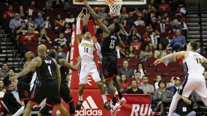 Clint Capela #15 of the Houston Rockets blocks a shot by