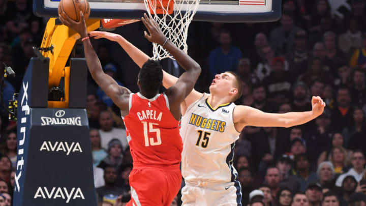 DENVER, CO - FEBRUARY 25: Nikola Jokic #15 of the Denver Nuggets defends against Clint Capela #15 of the Houston Rockets at Pepsi Center on February 25, 2018 in Denver, Colorado. NOTE TO USER: User expressly acknowledges and agrees that, by downloading and or using this photograph, User is consenting to the terms and conditions of the Getty Images License Agreement. (Photo by Justin Tafoya/Getty Images)