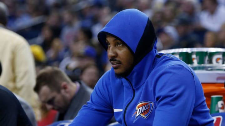 OAKLAND, CA - FEBRUARY 24: Carmelo Anthony #7 of the Oklahoma City Thunder looks on from the bench during the game against the Golden State Warriors at ORACLE Arena on February 24, 2018 in Oakland, California. NOTE TO USER: User expressly acknowledges and agrees that, by downloading and or using this photograph, User is consenting to the terms and conditions of the Getty Images License Agreement. (Photo by Lachlan Cunningham/Getty Images)