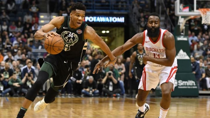 MILWAUKEE, WI - MARCH 07: Giannis Antetokounmpo #34 of the Milwaukee Bucks drives around James Harden #13 of the Houston Rockets during a game at the Bradley Center on March 7, 2018 in Milwaukee, Wisconsin. NOTE TO USER: User expressly acknowledges and agrees that, by downloading and or using this photograph, User is consenting to the terms and conditions of the Getty Images License Agreement. (Photo by Stacy Revere/Getty Images)