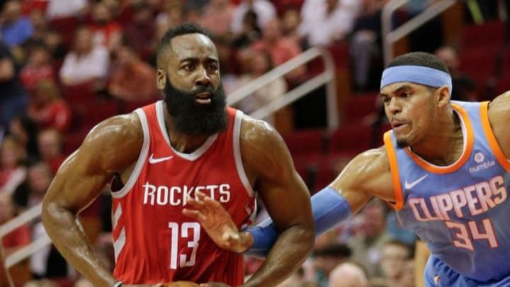 HOUSTON, TX - MARCH 15: James Harden #13 of the Houston Rockets drives past Tobias Harris #34 of the LA Clippers at Toyota Center on March 15, 2018 in Houston, Texas. NOTE TO USER: User expressly acknowledges and agrees that, by downloading and or using this photograph, User is consenting to the terms and conditions of the Getty Images License Agreement. (Photo by Bob Levey/Getty Images)
