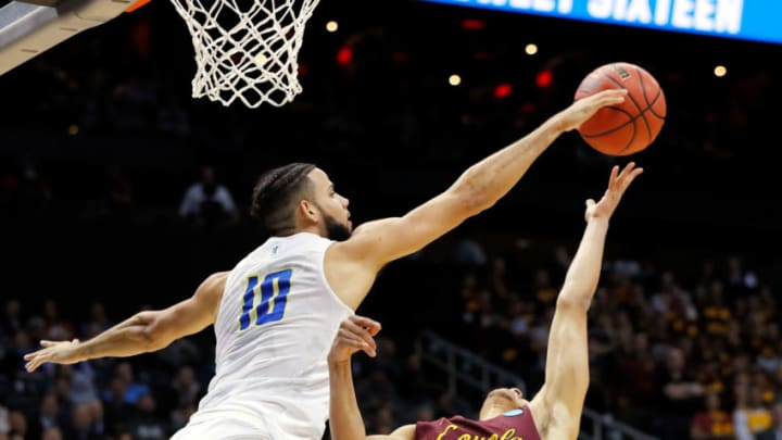 ATLANTA, GA - MARCH 22: Caleb Martin #10 of the Nevada Wolf Pack defends a shot from Lucas Williamson #1 of the Loyola Ramblers in the first half during the 2018 NCAA Men's Basketball Tournament South Regional at Philips Arena on March 22, 2018 in Atlanta, Georgia. (Photo by Kevin C. Cox/Getty Images)