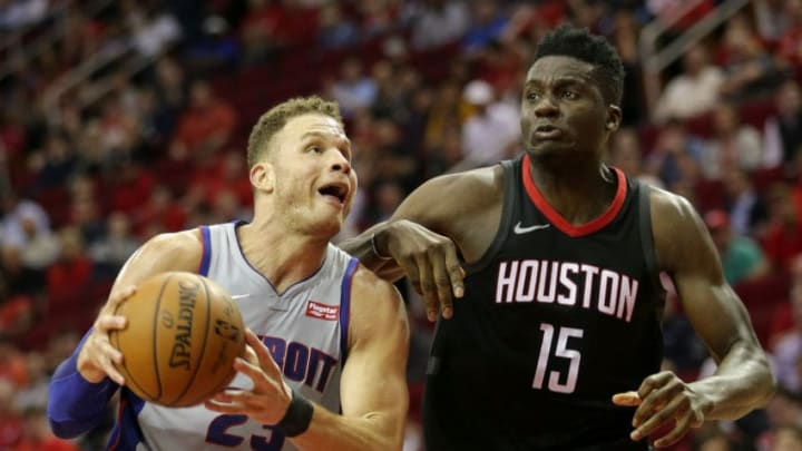 HOUSTON, TX - MARCH 22: Blake Griffin #23 of the Detroit Pistons drives around Clint Capela #15 of the Houston Rockets in the fourth quarter at Toyota Center on March 22, 2018 in Houston, Texas. NOTE TO USER: User expressly acknowledges and agrees that, by downloading and or using this photograph, User is consenting to the terms and conditions of the Getty Images License Agreement. (Photo by Bob Levey/Getty Images)