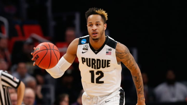 DETROIT, MI - MARCH 16: Purdue Boilermakers forward Vincent Edwards (12) brings the ball up the court during the NCAA Division I Men's Championship First Round basketball game between the Purdue Boilermakers and the Cal State Fullerton Titans on March 16, 2018 at Little Caesars Arena in Detroit, Michigan. (Photo by Scott W. Grau/Icon Sportswire via Getty Images)