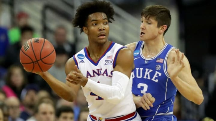 OMAHA, NE - MARCH 25: Devonte' Graham #4 of the Kansas Jayhawks looks to passes the ball against Grayson Allen #3 of the Duke Blue Devils during the first half in the 2018 NCAA Men's Basketball Tournament Midwest Regional at CenturyLink Center on March 25, 2018 in Omaha, Nebraska. (Photo by Streeter Lecka/Getty Images)