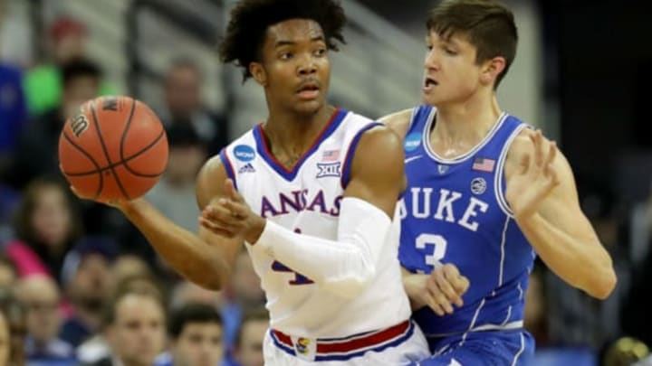 OMAHA, NE – MARCH 25: Devonte' Graham #4 of the Kansas Jayhawks looks to passes the ball against Grayson Allen #3 of the Duke Blue Devils during the first half in the 2018 NCAA Men's Basketball Tournament Midwest Regional at CenturyLink Center on March 25, 2018 in Omaha, Nebraska. (Photo by Streeter Lecka/Getty Images)