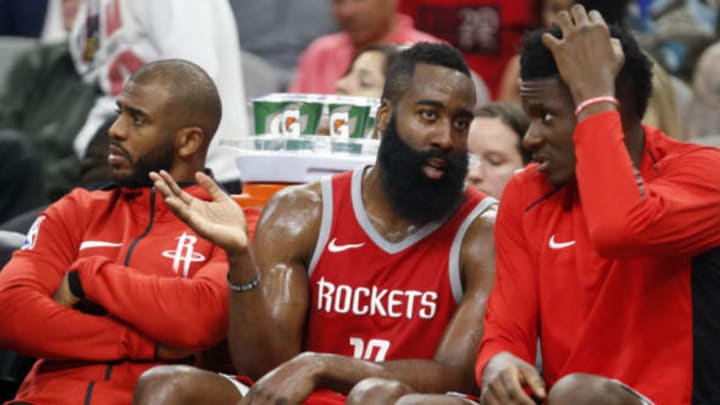 SAN ANTONIO,TX – APRIL 1 : James Harden #13 of the Houston Rockets talks with teammate Clint Capela #15 of the Houston Rockets while Chris Paul #3 of the Houston Rockets,L watches the game at AT&T Center on April 1 , 2018 in San Antonio, Texas. NOTE TO USER: User expressly acknowledges and agrees that , by downloading and or using this photograph, User is consenting to the terms and conditions of the Getty Images License Agreement. (Photo by Ronald Cortes/Getty Images)