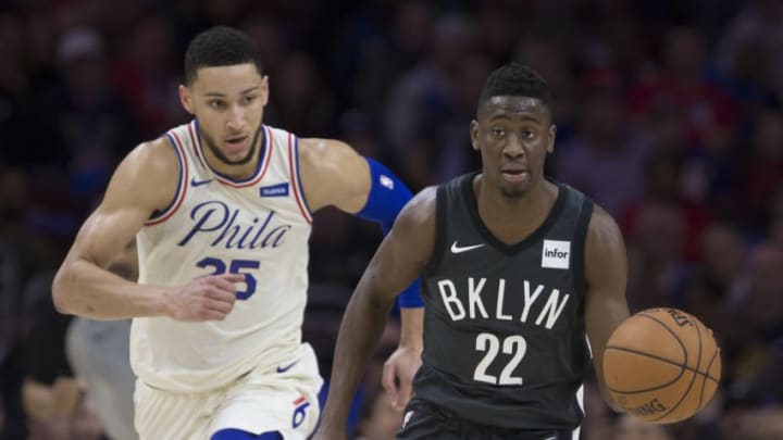 Caris LeVert #22 of the Brooklyn Nets drives to the basket against Ben Simmons #25 of the Philadelphia 76ers (Photo by Mitchell Leff/Getty Images)