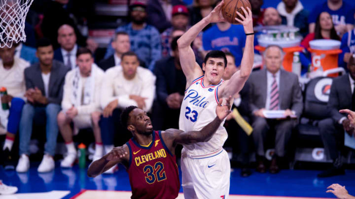 PHILADELPHIA, PA - APRIL 06: Philadelphia 76ers Forward Ersan Ilyasova (23) grabs a rebound over Cleveland Cavaliers Forward Jeff Green (32) in the first half during the game between the Cleveland Cavaliers and Philadelphia 76ers on April 06, 2018 at Wells Fargo Center in Philadelphia, PA. (Photo by Kyle Ross/Icon Sportswire via Getty Images)