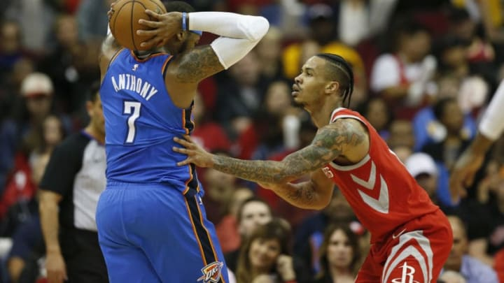 HOUSTON, TX - APRIL 07: Carmelo Anthony #7 of the Oklahoma City Thunder controls the ball defended by Gerald Green #14 of the Houston Rockets in the first half at Toyota Center on April 7, 2018 in Houston, Texas. NOTE TO USER: User expressly acknowledges and agrees that, by downloading and or using this Photograph, user is consenting to the terms and conditions of the Getty Images License Agreement. (Photo by Tim Warner/Getty Images)