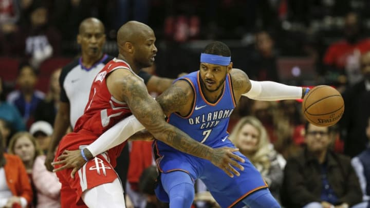 HOUSTON, TX - APRIL 07: PJ Tucker #4 of the Houston Rockets defends Carmelo Anthony #7 of the Oklahoma City Thunder in the first half at Toyota Center on April 7, 2018 in Houston, Texas. NOTE TO USER: User expressly acknowledges and agrees that, by downloading and or using this Photograph, user is consenting to the terms and conditions of the Getty Images License Agreement. (Photo by Tim Warner/Getty Images)