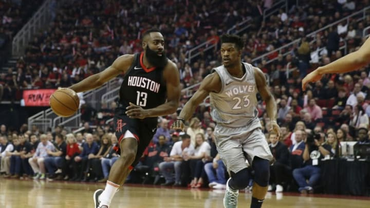 HOUSTON, TX - APRIL 15: James Harden #13 of the Houston Rockets drives to the basket against Jimmy Butler #23 of the Minnesota Timberwolves in the first half during Game One of the first round of the 2018 NBA Playoffs at Toyota Center on April 15, 2018 in Houston, Texas. NOTE TO USER: User expressly acknowledges and agrees that, by downloading and or using this photograph, User is consenting to the terms and conditions of the Getty Images License Agreement. (Photo by Tim Warner/Getty Images)