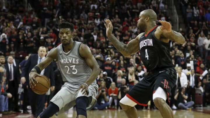 HOUSTON, TX - APRIL 15: Jimmy Butler #23 of the Minnesota Timberwolves dribbles the ball defended by PJ Tucker #4 of the Houston Rockets in the second half during Game One of the first round of the 2018 NBA Playoffs at Toyota Center on April 15, 2018 in Houston, Texas. NOTE TO USER: User expressly acknowledges and agrees that, by downloading and or using this photograph, User is consenting to the terms and conditions of the Getty Images License Agreement. (Photo by Tim Warner/Getty Images)