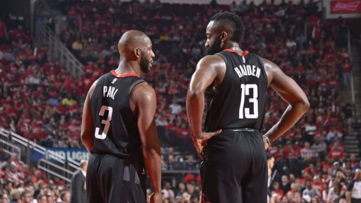 HOUSTON, TX - APRIL 18: Chris Paul #3 of the Houston Rockets speaks to James Harden #13 of the Houston Rockets during the game against the Minnesota Timberwolves during Game Two of Round One of the 2018 NBA Playoffs on April 18, 2018 at the Toyota Center in Houston, Texas. NOTE TO USER: User expressly acknowledges and agrees that, by downloading and or using this photograph, User is consenting to the terms and conditions of the Getty Images License Agreement. Mandatory Copyright Notice: Copyright 2018 NBAE (Photo by Bill Baptist/NBAE via Getty Images)