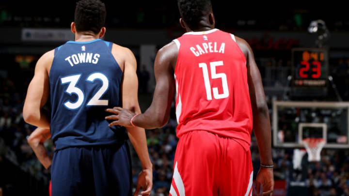 MINNEAPOLIS, MN - APRIL 21: Karl-Anthony Towns #32 of the Minnesota Timberwolves and Clint Capela #15 of the Houston Rockets look on during Game Three of Round One of the 2018 NBA Playoffs on April 21, 2018 at Target Center in Minneapolis, Minnesota. NOTE TO USER: User expressly acknowledges and agrees that, by downloading and or using this Photograph, user is consenting to the terms and conditions of the Getty Images License Agreement. Mandatory Copyright Notice: Copyright 2018 NBAE (Photo by David Sherman/NBAE via Getty Images)