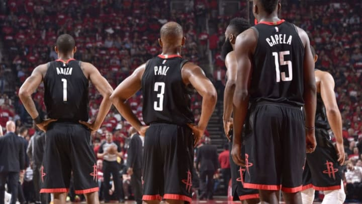 HOUSTON, TX - MAY 2: Trevor Ariza #1 of the Houston Rockets, Chris Paul #3 of the Houston Rockets, James Harden #13 of the Houston Rockets, and Clint Capela #15 of the Houston Rockets look on during the game against the Utah Jazz in Game Two of Round Two of the 2018 NBA Playoffs on May 2, 2018 at the Toyota Center in Houston, Texas. NOTE TO USER: User expressly acknowledges and agrees that, by downloading and or using this photograph, User is consenting to the terms and conditions of the Getty Images License Agreement. Mandatory Copyright Notice: Copyright 2018 NBAE (Photo by Bill Baptist/NBAE via Getty Images)