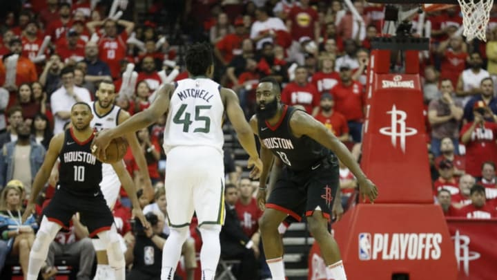 HOUSTON, TX - MAY 02: James Harden #13 of the Houston Rockets defends Donovan Mitchell #45 of the Utah Jazz in the second half during Game Two of the Western Conference Semifinals of the 2018 NBA Playoffs at Toyota Center on May 2, 2018 in Houston, Texas. NOTE TO USER: User expressly acknowledges and agrees that, by downloading and or using this photograph, User is consenting to the terms and conditions of the Getty Images License Agreement. (Photo by Tim Warner/Getty Images)