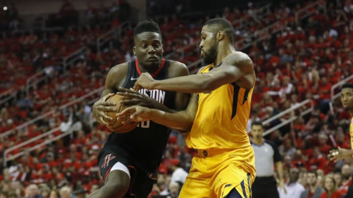 HOUSTON, TX - APRIL 29: Clint Capela #15 of the Houston Rockets drives to the basket defended by Derrick Favors #15 of the Utah Jazz in the second half during Game One of the Western Conference Semifinals of the 2018 NBA Playoffs at Toyota Center on April 29, 2018 in Houston, Texas. NOTE TO USER: User expressly acknowledges and agrees that, by downloading and or using this photograph, User is consenting to the terms and conditions of the Getty Images License Agreement. (Photo by Tim Warner/Getty Images)
