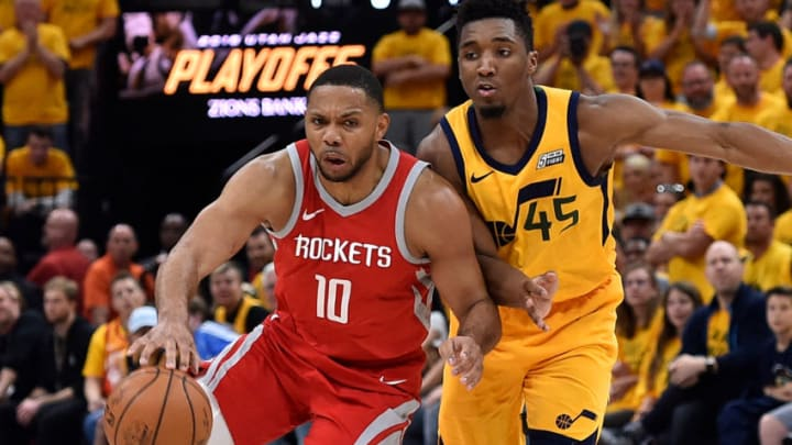 SALT LAKE CITY, UT - MAY 06: Eric Gordon #10 of the Houston Rockets drives around Donovan Mitchell #45 of the Utah Jazz in the second half during Game Four of Round Two of the 2018 NBA Playoffs at Vivint Smart Home Arena on May 6, 2018 in Salt Lake City, Utah. The Rockets beat the Jazz 100-87. NOTE TO USER: User expressly acknowledges and agrees that, by downloading and or using this photograph, User is consenting to the terms and conditions of the Getty Images License Agreement. (Photo by Gene Sweeney Jr./Getty Images)