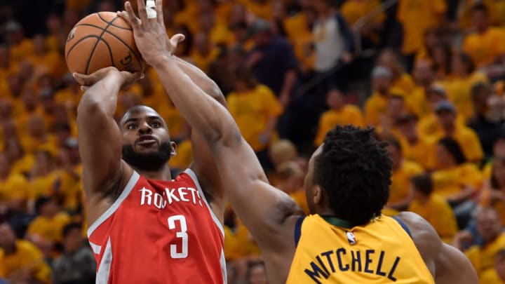 SALT LAKE CITY, UT - MAY 06: Chris Paul #3 of the Houston Rockets shoots over Donovan Mitchell #45 of the Utah Jazz in the second half during Game Four of Round Two of the 2018 NBA Playoffs at Vivint Smart Home Arena on May 6, 2018 in Salt Lake City, Utah. The Rockets beat the Jazz 100-87. NOTE TO USER: User expressly acknowledges and agrees that, by downloading and or using this photograph, User is consenting to the terms and conditions of the Getty Images License Agreement. (Photo by Gene Sweeney Jr./Getty Images)