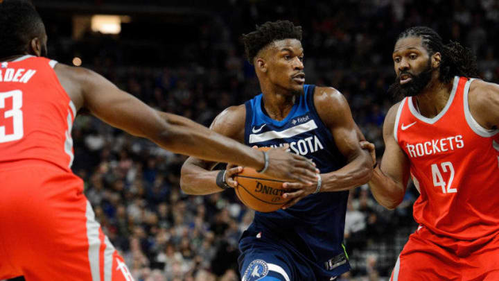 MINNEAPOLIS, MN - APRIL 21: Jimmy Butler #23 of the Minnesota Timberwolves drives to the basket against James Harden #13 and Nene Hilario #42 of the Houston Rockets in Game Three of Round One of the 2018 NBA Playoffs on April 21, 2018 at the Target Center in Minneapolis, Minnesota. The Timberwolves defeated 121-105. NOTE TO USER: User expressly acknowledges and agrees that, by downloading and or using this Photograph, user is consenting to the terms and conditions of the Getty Images License Agreement. (Photo by Hannah Foslien/Getty Images)