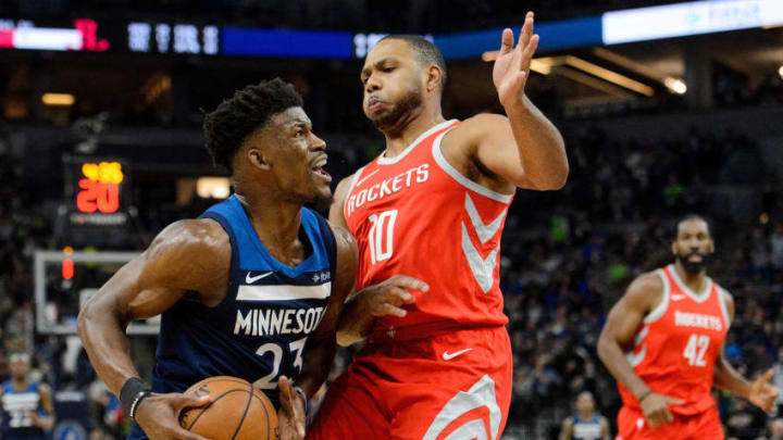 MINNEAPOLIS, MN - APRIL 21: Eric Gordon #10 of the Houston Rockets defends Jimmy Butler #23 of the Minnesota Timberwolves in Game Three of Round One of the 2018 NBA Playoffs on April 21, 2018 at the Target Center in Minneapolis, Minnesota. The Timberwolves defeated 121-105. NOTE TO USER: User expressly acknowledges and agrees that, by downloading and or using this Photograph, user is consenting to the terms and conditions of the Getty Images License Agreement. (Photo by Hannah Foslien/Getty Images)
