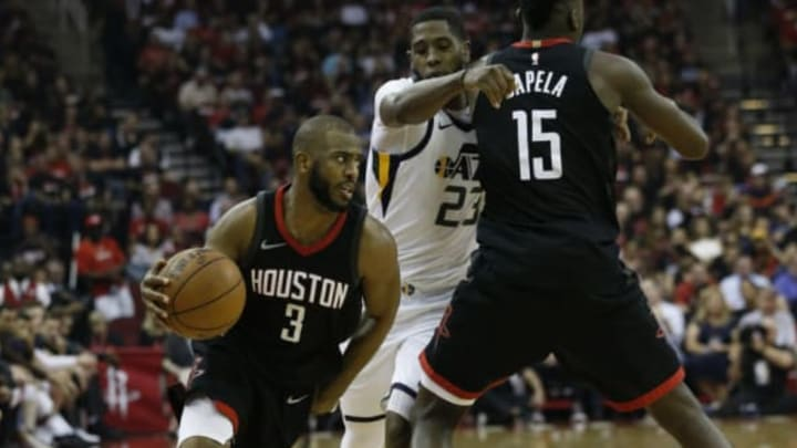 HOUSTON, TX – MAY 08: Chris Paul #3 of the Houston Rockets drives past Royce O'Neale #23 of the Utah Jazz as he receives a pick from Clint Capela #15 during Game Five of the Western Conference Semifinals of the 2018 NBA Playoffs at Toyota Center on May 8, 2018 in Houston, Texas. NOTE TO USER: User expressly acknowledges and agrees that, by downloading and or using this photograph, User is consenting to the terms and conditions of the Getty Images License Agreement. (Photo by Bob Levey/Getty Images)