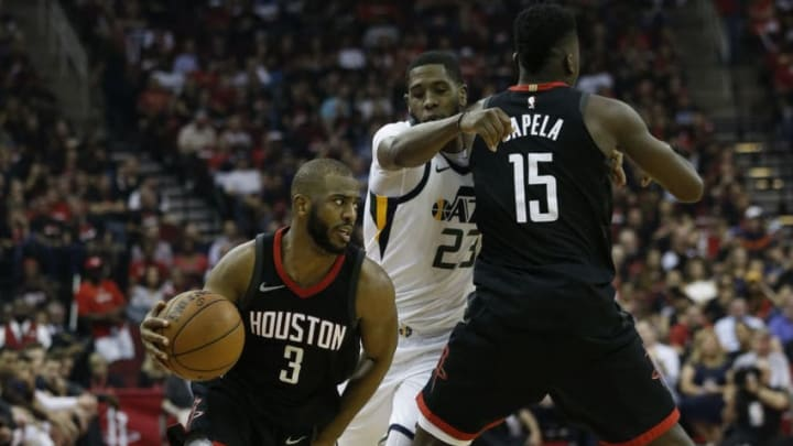 HOUSTON, TX - MAY 08: Chris Paul #3 of the Houston Rockets drives past Royce O'Neale #23 of the Utah Jazz as he receives a pick from Clint Capela #15 during Game Five of the Western Conference Semifinals of the 2018 NBA Playoffs at Toyota Center on May 8, 2018 in Houston, Texas. NOTE TO USER: User expressly acknowledges and agrees that, by downloading and or using this photograph, User is consenting to the terms and conditions of the Getty Images License Agreement. (Photo by Bob Levey/Getty Images)