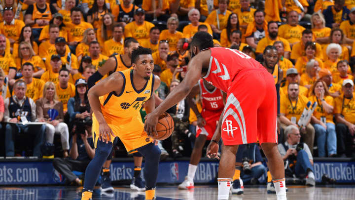 SALT LAKE CITY, UT - MAY 6: Donovan Mitchell #45 of the Utah Jazz defends against James Harden #13 of the Houston Rockets during Game Four of the Western Conference Semifinals of the 2018 NBA Playoffs on May 6, 2018 at the Vivint Smart Home Arena Salt Lake City, Utah. NOTE TO USER: User expressly acknowledges and agrees that, by downloading and or using this photograph, User is consenting to the terms and conditions of the Getty Images License Agreement. Mandatory Copyright Notice: Copyright 2018 NBAE (Photo by Andrew D. Bernstein/NBAE via Getty Images)