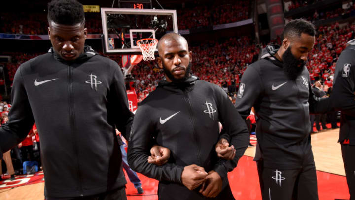 HOUSTON, TX - MAY 14: James Harden #13, Chris Paul #3 and Clint Capela #15 of the Houston Rockets honor the National Anthem before the game against the Golden State Warriors in Game One of the Western Conference Finals of the 2018 NBA Playoffs on May 14, 2018 at the Toyota Center in Houston, Texas. NOTE TO USER: User expressly acknowledges and agrees that, by downloading and or using this photograph, User is consenting to the terms and conditions of the Getty Images License Agreement. Mandatory Copyright Notice: Copyright 2018 NBAE (Photo by Bill Baptist/NBAE via Getty Images)