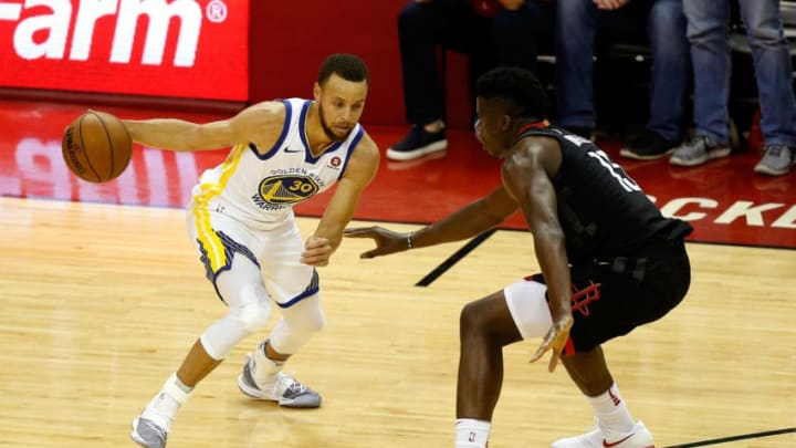 Stephen Curry #30 of the Golden State Warriors handles the ball against Clint Capela #15 of the Houston Rockets
