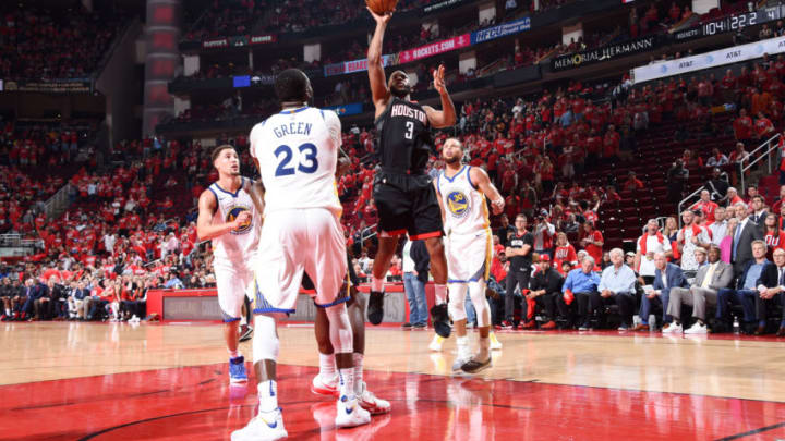 HOUSTON, TX - MAY 14: Chris Paul #3 of the Houston Rockets shoots the ball against the Golden State Warriors during Game One of the Western Conference Finals of the 2018 NBA Playoffs on May 14, 2018 at the Toyota Center in Houston, Texas. NOTE TO USER: User expressly acknowledges and agrees that, by downloading and or using this photograph, User is consenting to the terms and conditions of the Getty Images License Agreement. Mandatory Copyright Notice: Copyright 2018 NBAE (Photo by Andrew D. Bernstein/NBAE via Getty Images)