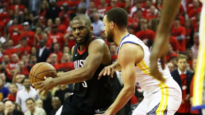 HOUSTON, TX - MAY 16: Chris Paul #3 of the Houston Rockets drives against Stephen Curry #30 of the Golden State Warriors in the first half of Game Two of the Western Conference Finals of the 2018 NBA Playoffs at Toyota Center on May 16, 2018 in Houston, Texas. (Photo by Ronald Martinez/Getty Images)
