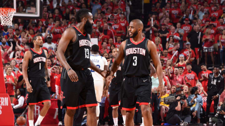 HOUSTON, TX - MAY 14: James Harden #13 and Chris Paul #3 of the Houston Rockets talk in Game One of the Western Conference Finals against the Golden State Warriors during the 2018 NBA Playoffs on May 14, 2018 at the Toyota Center in Houston, Texas. NOTE TO USER: User expressly acknowledges and agrees that, by downloading and or using this photograph, User is consenting to the terms and conditions of the Getty Images License Agreement. Mandatory Copyright Notice: Copyright 2018 NBAE (Photo by Andrew D. Bernstein/NBAE via Getty Images)